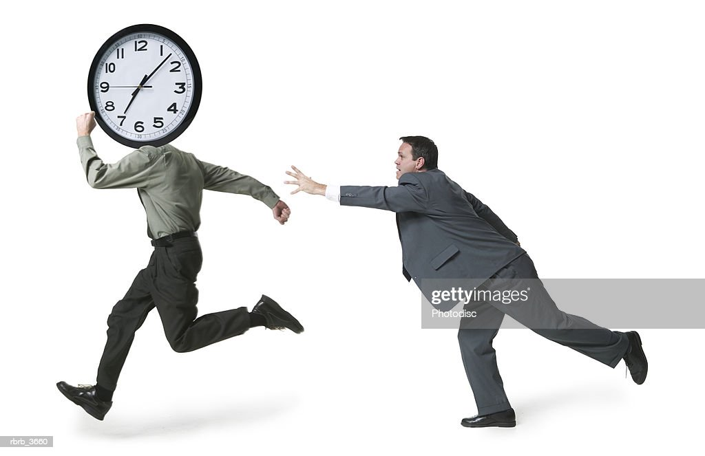 Side profile of a mature men running holding a clock : Foto de stock