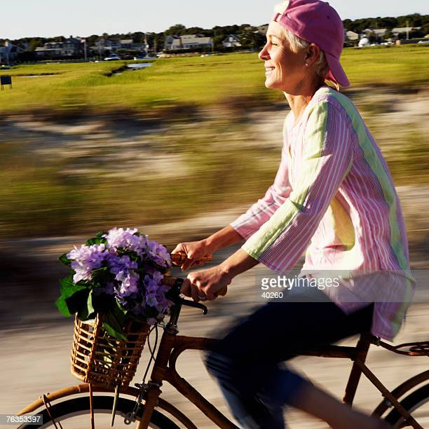 Side profile of a mature woman riding a bicycle
