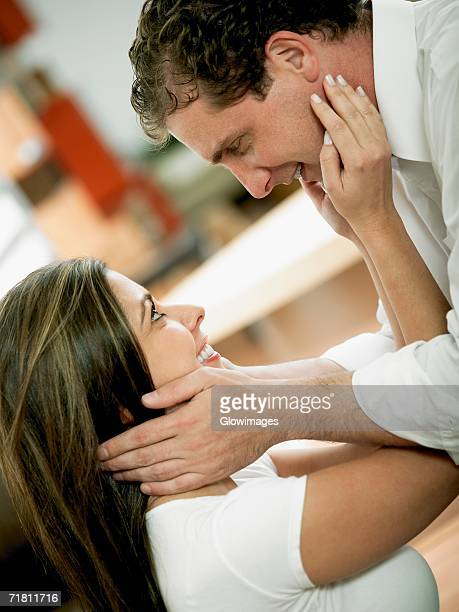 side profile of a mid adult couple looking at each other and smiling - girlfriend stock pictures, royalty-free photos & images