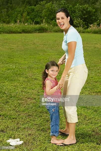 Side profile of a mother and her daughter smiling