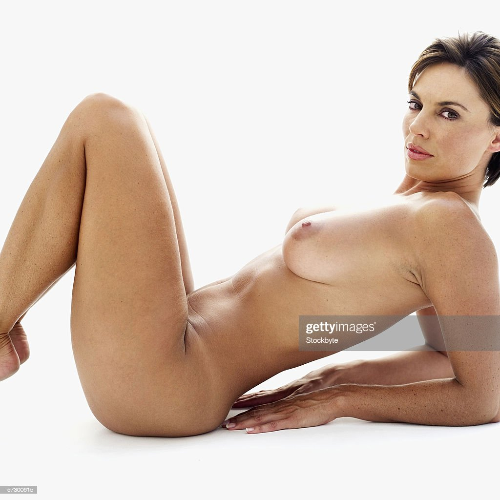 side profile of a nude young woman with legs lifted up stock photo