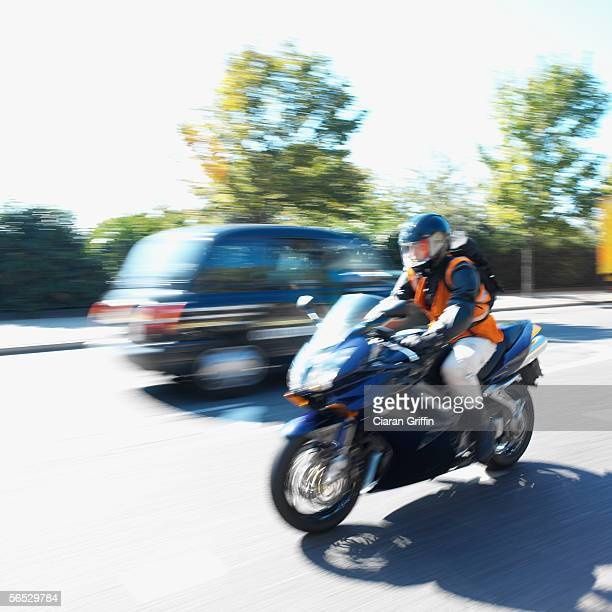 side profile of a person riding a motorcycle