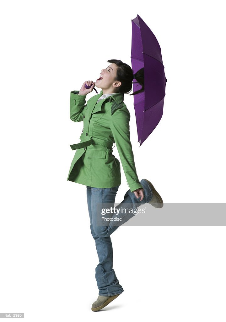 Side profile of a teenage girl holding an umbrella : Foto de stock