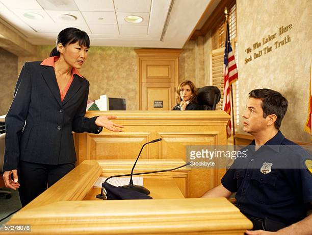 side profile of a witness and a lawyer on the witness stand, with the judge listening - witness stock pictures, royalty-free photos & images