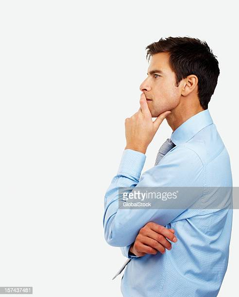 Side profile of a young businessman contemplating