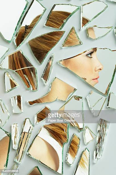 Side profile of a young lady in broken mirrors