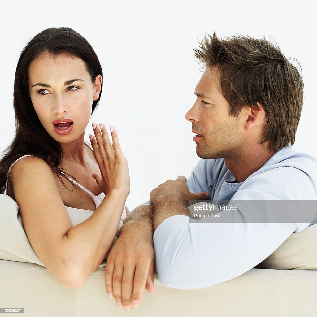 side profile of a young man arguing with a young woman : Stock Photo