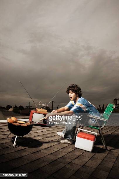 Side profile of a young man cooking food