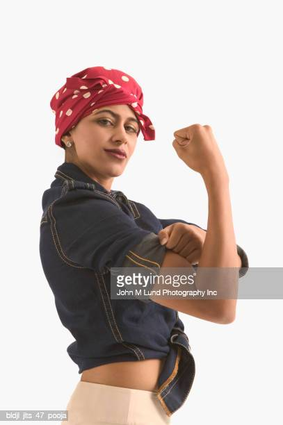 side profile of a young woman flexing her arm muscle - rolled up sleeves stock pictures, royalty-free photos & images