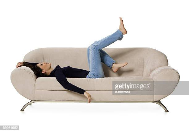 Side profile of a young woman lying on a couch