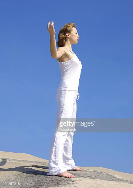 Side profile of a young woman practicing yoga
