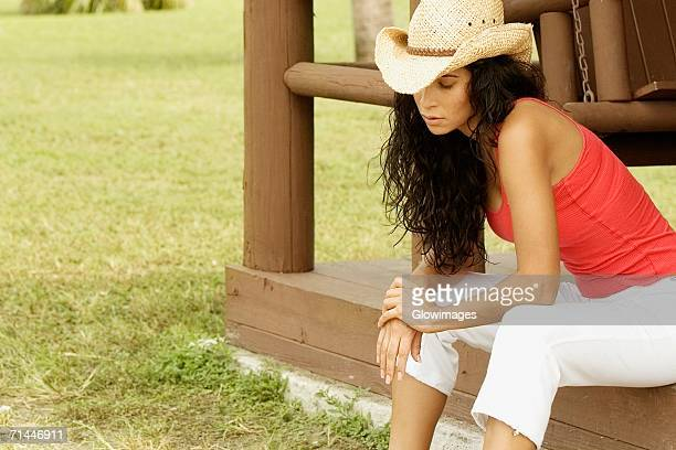 side profile of a young woman sitting on the ledge with her eyes closed - pedal pushers stock pictures, royalty-free photos & images