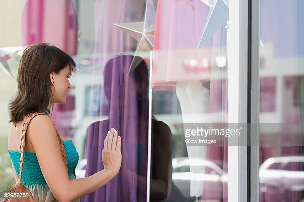 Side profile of a young woman window shopping
