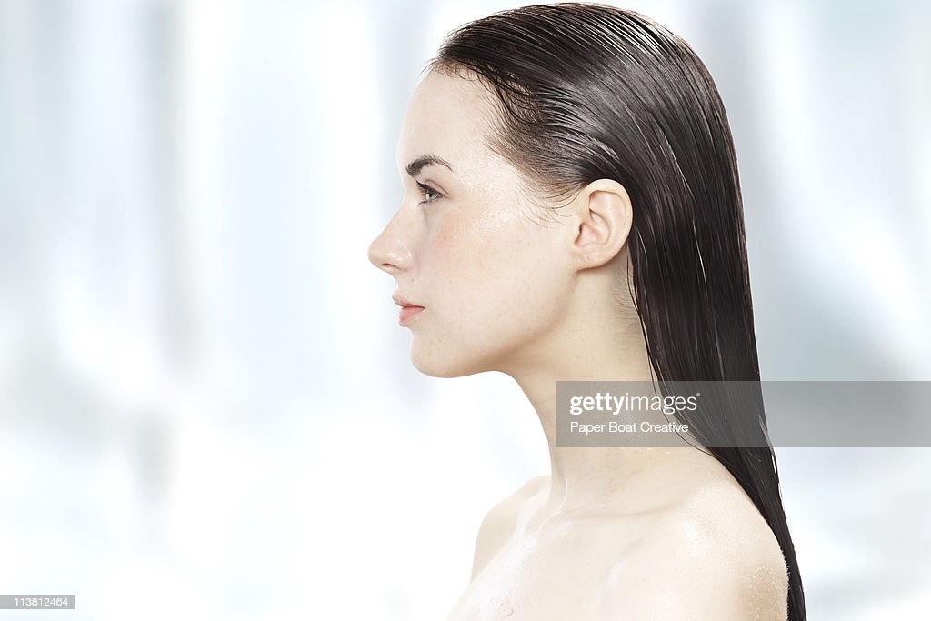 side profile of a young woman with her hair wet stock photo getty