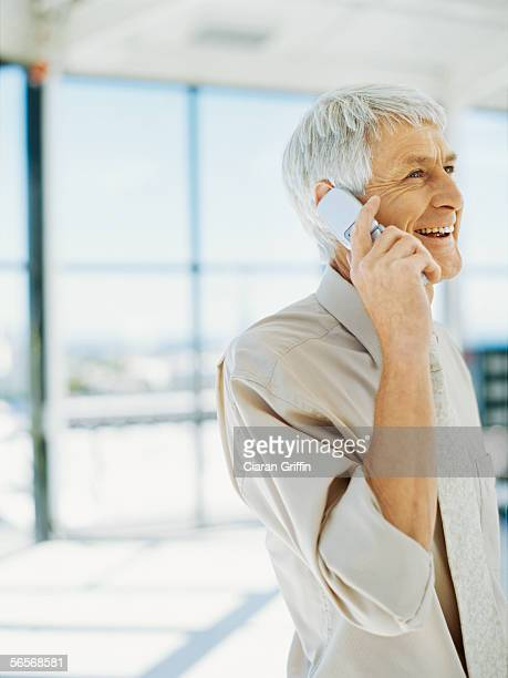 side profile of an businessman talking on a mobile phone in an office