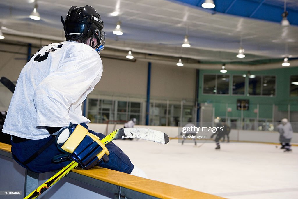 Side profile of an ice hockey player watching ice hockey : Stock Photo