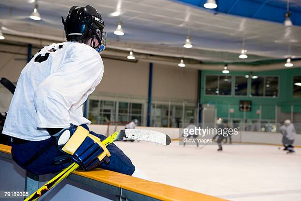 side profile of an ice hockey player watching ice hockey - ice hockey uniform stock pictures, royalty-free photos & images