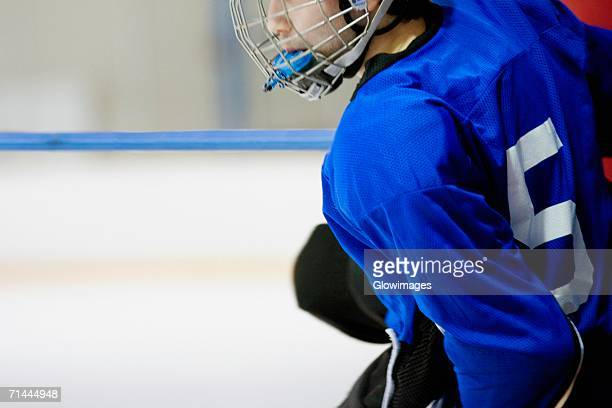 Side profile of an ice hockey player wearing a helmet