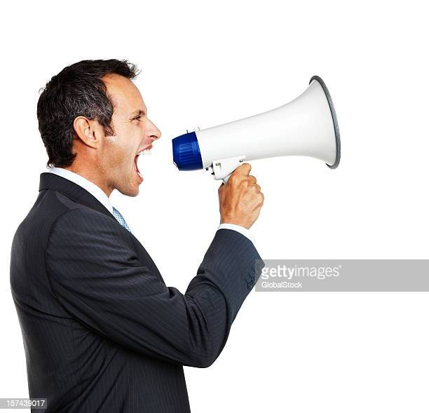 side profile of businessman shouting in a megaphone - furious stock pictures, royalty-free photos & images