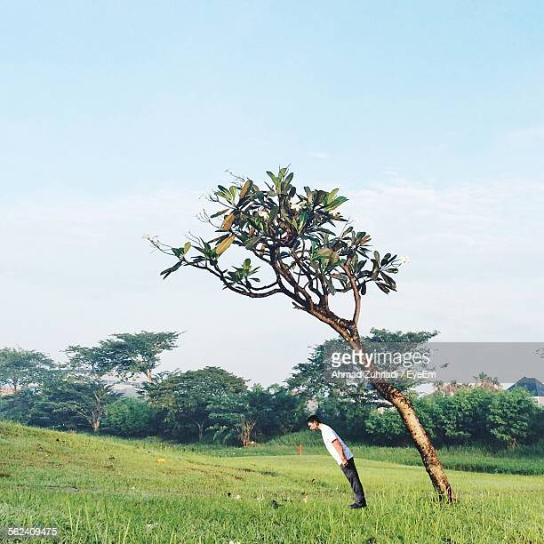 Side Profile Of Man Bending Like Tree