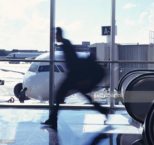 side profile of man rushing in the airport