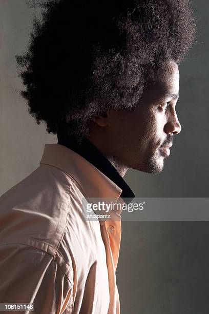 Side Profile of Man with Afro Hairstyle, Low Key