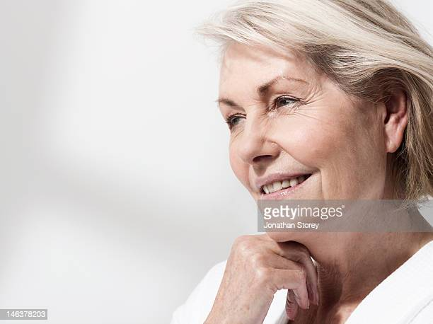 Side profile of mature womans face looking ahead