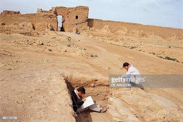 Side profile of two archaeologists at an archeological site DuraEuropus Syria