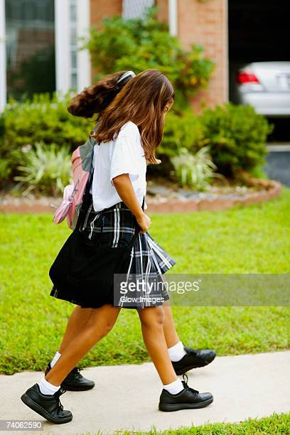 side profile of two schoolgirls walking - school girl shoes stock pictures, royalty-free photos & images