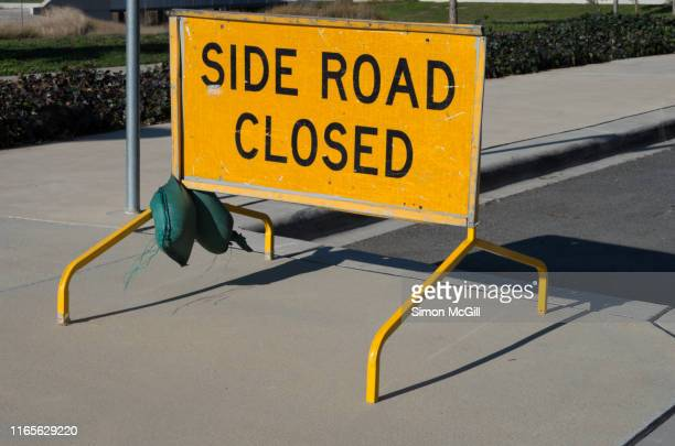 'side road closed' sign on the footpath by the side of a road - rules stock pictures, royalty-free photos & images