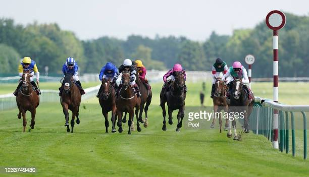 Side Shot and Robert Havlin coming home to win the Watch On Racing TV Handicap at Haydock Park Racecourse on July 1, 2021 in Newton-le-Willows,...