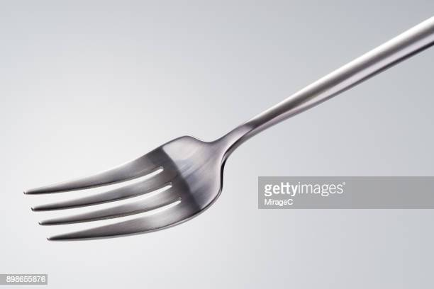 side shot of a silver colored fork - forchetta foto e immagini stock