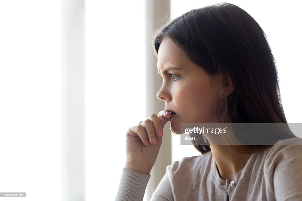 Side view face of serious woman thinking about problem : Stock Photo