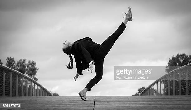 Side View Full Length Of Woman Dancing On Footbridge