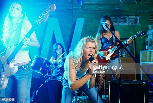 side view of a band playing - girl band stock pictures, royalty-free photos & images