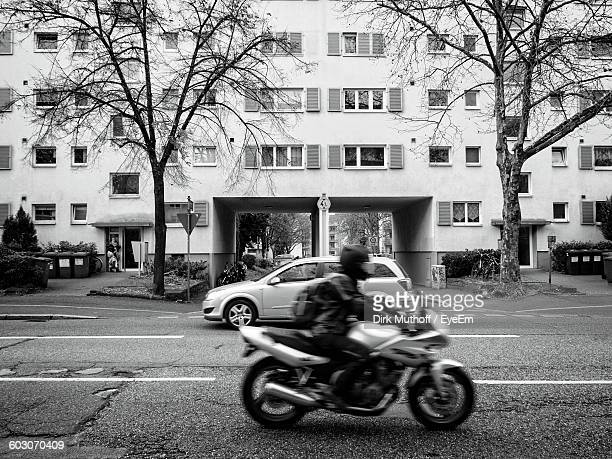 Side View Of A Blurred Man Riding Motorcycle