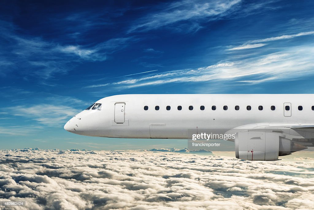 side view of a commercial airplane flying : Stock Photo