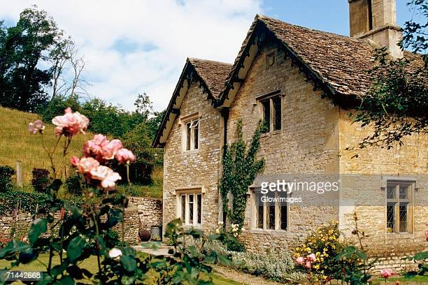 Side view of a cottage with a garden in its front, Castle Combe, England