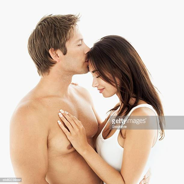 side view of a couple - chest kissing stock photos and pictures