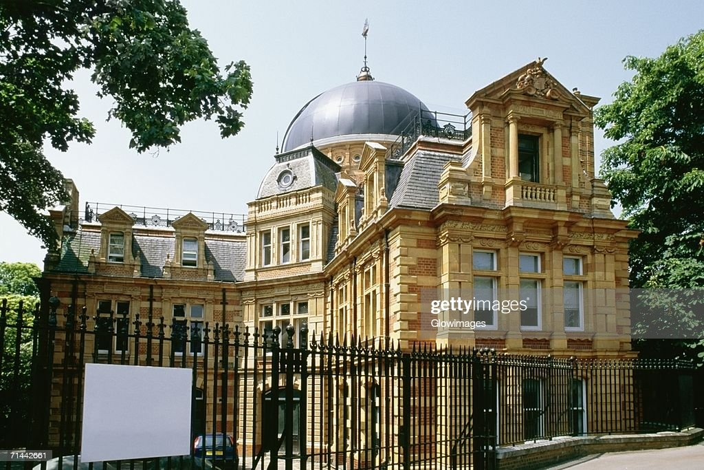 Side view of a domed building adjacent to Royal Observatory, Greenwich, England : Stock Photo