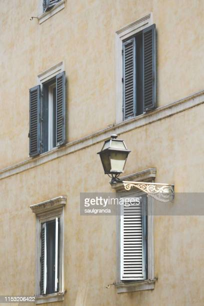 side view of a facade in rome - beige stock pictures, royalty-free photos & images