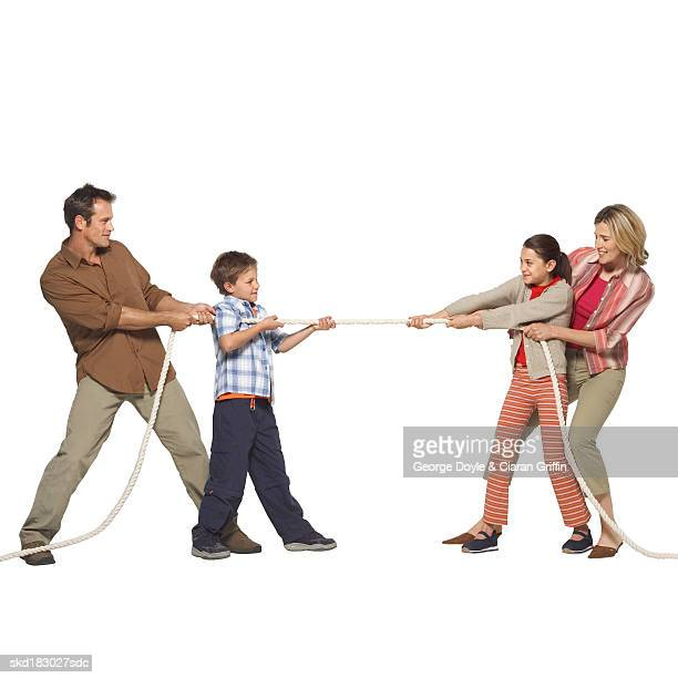 Side view of a family playing tug of war