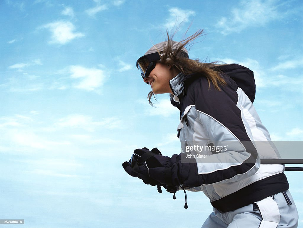 Side View of a Female Skier : Stock Photo