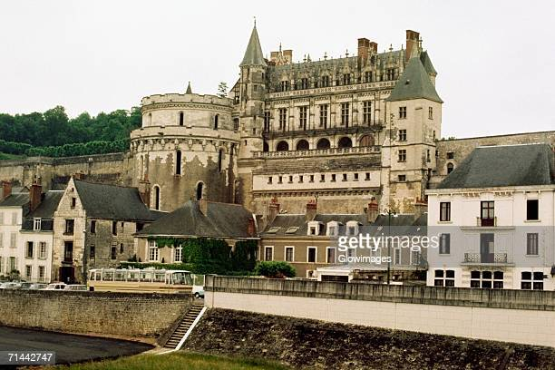 Side view of a grand chateau amidst a series of cottages, Amboise, France