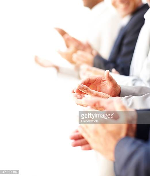 Side view of a group of business colleagues clapping hands