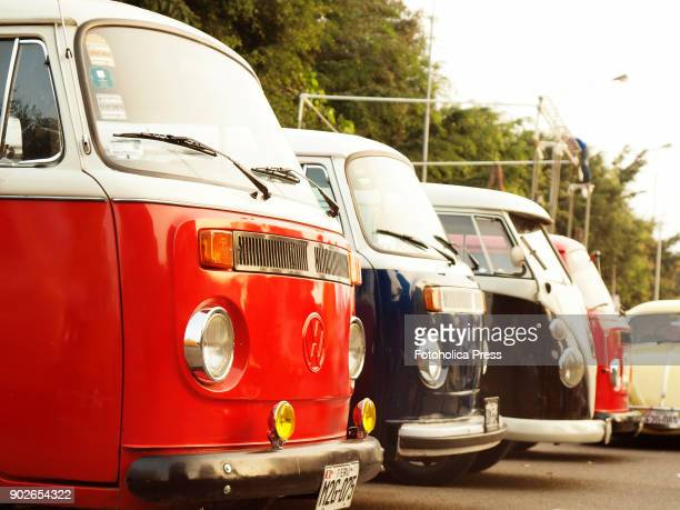 Side view of a group of four Volkswagen T1 T2 Brazilian Kombi