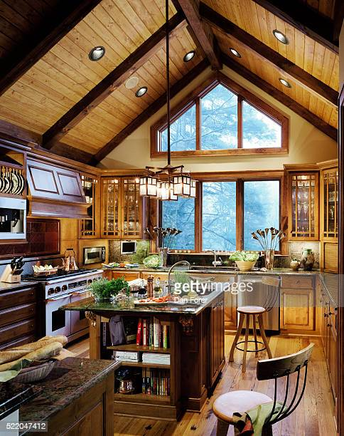 Side view of a kitchen having tapering ceiling