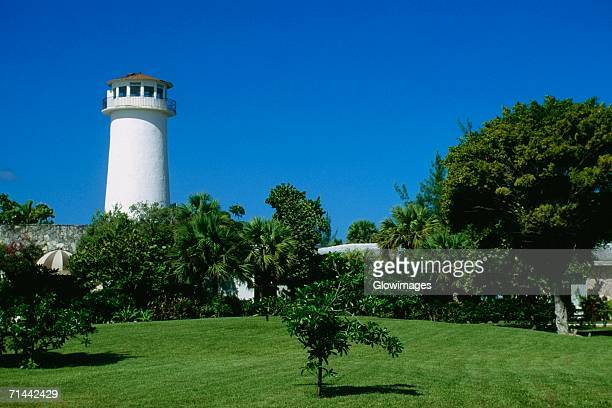 side view of a lighthouse at lucayan beach resort, freeport, grand bahamas, bahamas - freeport bahamas stock photos and pictures