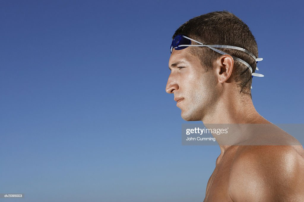 Side View of a Male Swimmer : Stock Photo