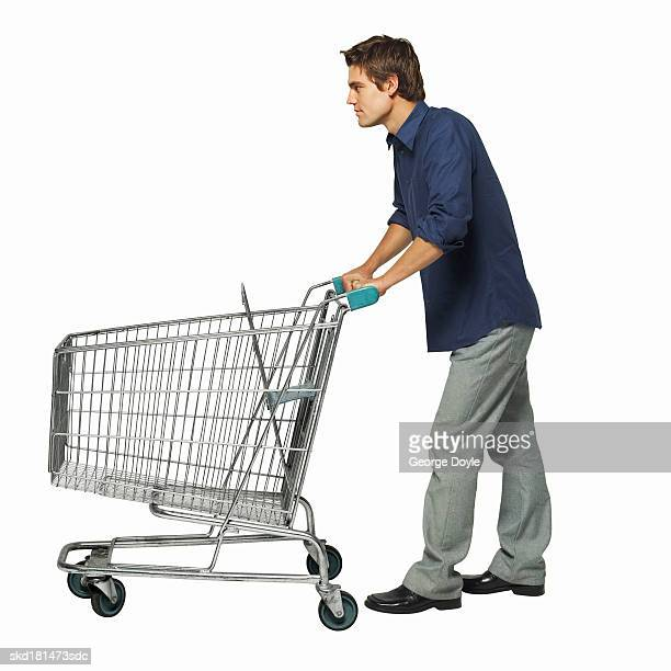 side view of a man pushing a trolley